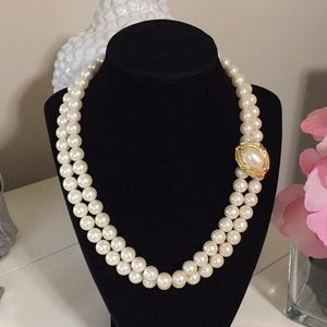 Double strand of pearls necklace gold frame pearl